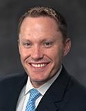 Commissioner Toby Baker