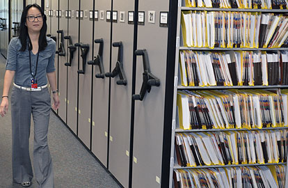 Contract worker Yukio Nemoto walks along the rolling stack shelving in the TCEQ's Central File Room. The stacks allow for more files to be stored in a smaller space.