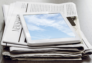 Newspaper and tablet.