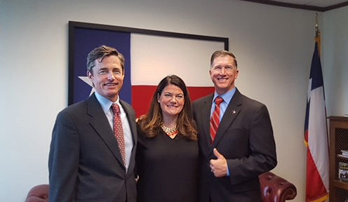 Commissioner Emily Lindley (center) is flanked by two chairmen—new Chairman Jon Niermann (left) and retired Chairman Bryan W. Shaw.