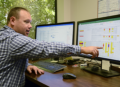 Among the many tools at his disposal, Weslee Copeland, the lead meteorologist for the TCEQ's Monitoring Division, explains the modeling software he uses. The program, which he helped to develop, collects and analyzes atmospheric data to create a baseline air quality forecast.