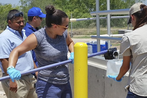 Jackie Keltner, an environmental investigator in TCEQ's Harlingen region, collects effluent samples at a wastewater treatment plant.