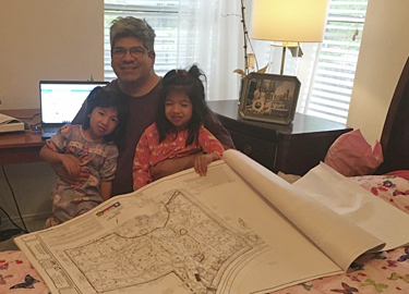 Bob Castro teaches his kids how to review Edwards Aquifer plans.