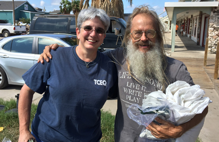 Susan Clewis hands out safety supplies to a Port Aransas resident after Hurricane Harvey.