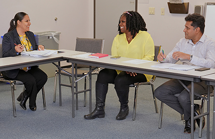 Yolanda Davis (center) meets with her staff to discuss financial issues.
