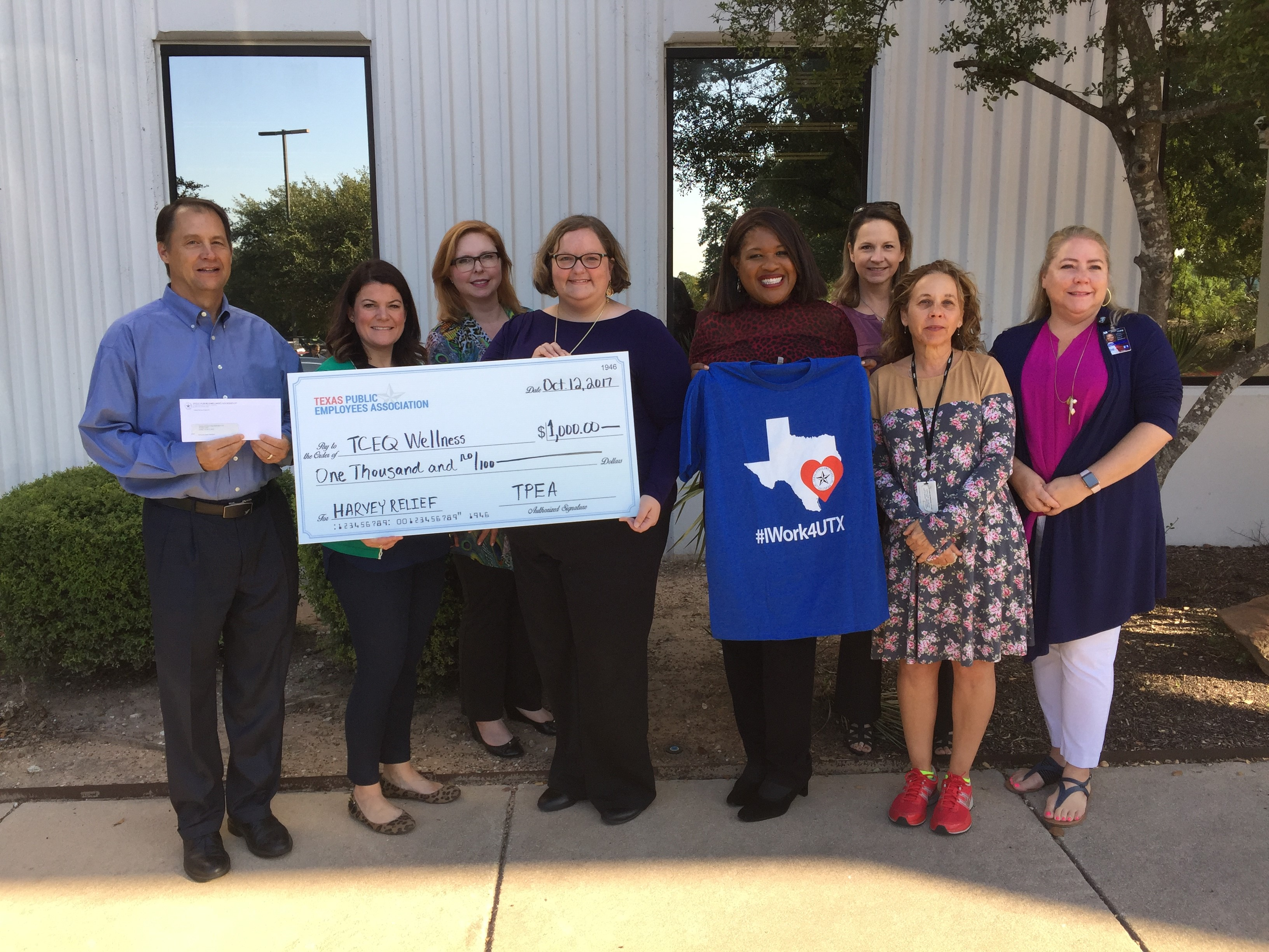 Personnel from the TCEQ Hurricane Relief Committee accept a gift from the Texas Public Employees Association.