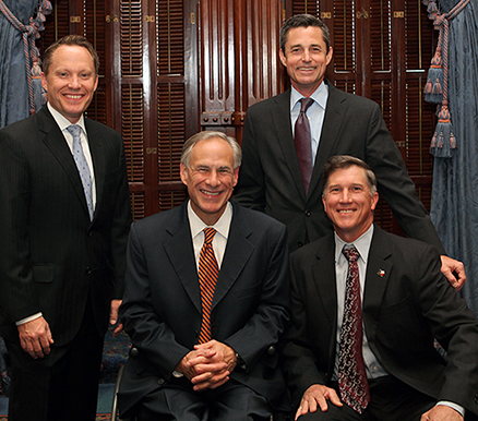 TCEQ Commissioners Toby Baker (standing, left), Jon Niermann (standing, right), and Chairman Bryan W. Shaw, Ph.D., P.E., (seated, right) meet with Texas Gov. Greg Abbott in May at the Capitol during the governor's visit with recipients of the Texas Environmental Excellence Awards, the state's highest environmental award.