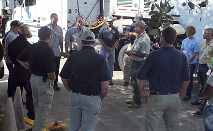 Director of TCEQ's Critical Infrastructure Division, Kelly Cook, sixth from the left, address emergency responders before they deployed to hurricane-stricken areas.