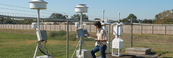 Erin McDonald, a work leader in TCEQ's Monitoring Division, checks on a stationary air monitoring site.