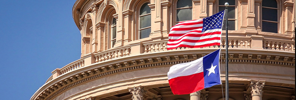 American and Texas Flags fly at Texas Capitol