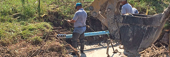 Workers from Jonah Special Utility District repair pipelines near Holiday Beach