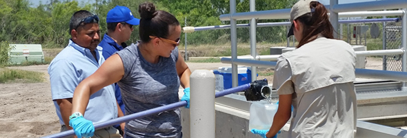 Jackie Keltner collects effluent samples at a wastewater treatment plant.