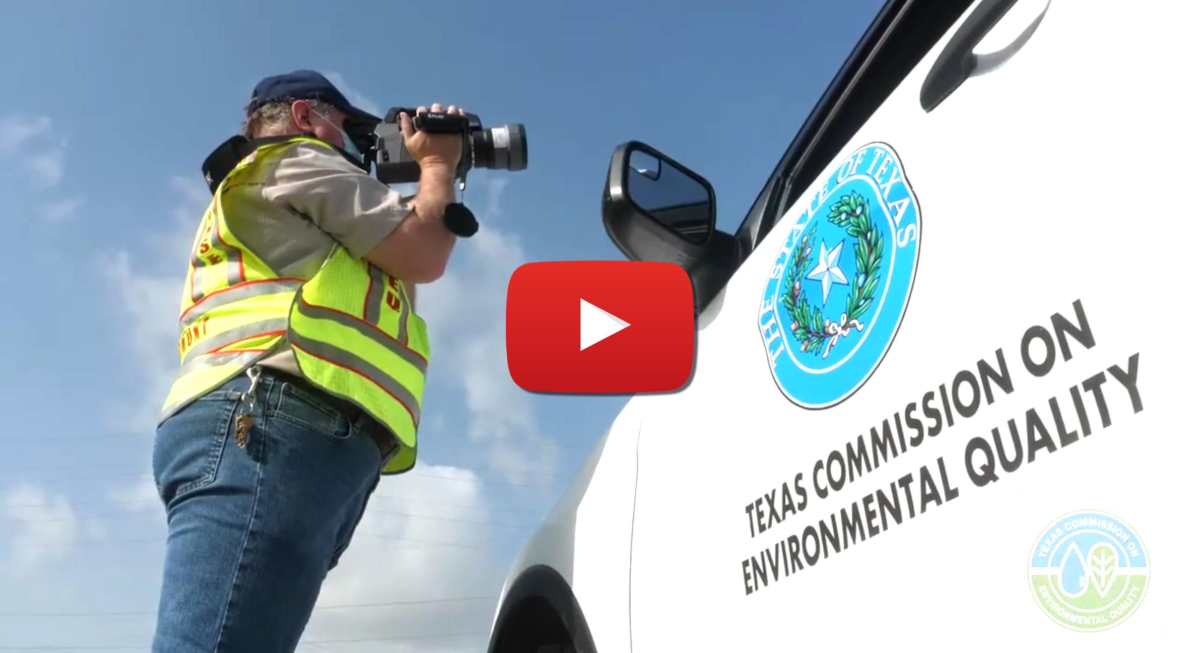 A TCEQ employee filming near a TCEQ vehicle